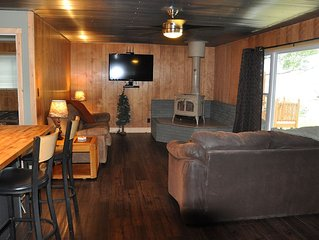 Quiet Place to enjoy the beautiful scenery of Manistee Lake! Private Dock!