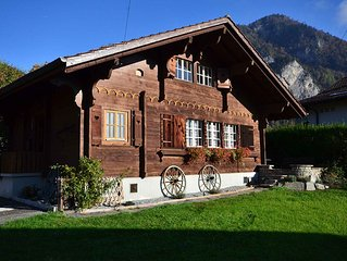 Swiss Traditional Chalet with view of the Alps