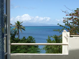 A Touch of Glass Beach House, private beachfront villa walking distance to town