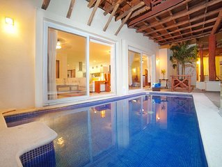 Steps from the beach with private heated pool and incredible views