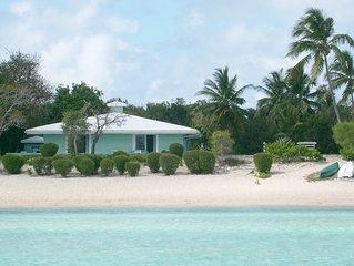 The Barefoot Beach House sits on a sandy beach