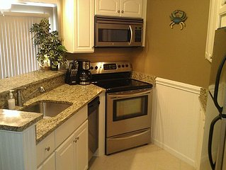 Bay Front Condo w/ Pool One Block from the Beach!