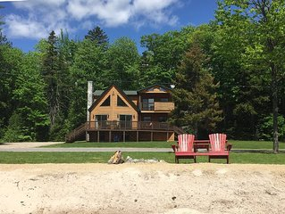 Lakefront Log Home with sandy beach
