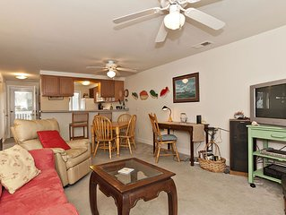 Well appointed 2nd floor courtyard condo just steps away from the beach