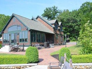 Escape to Birch Haven! Winnipesaukee luxury home w/ 2 docks, swim raft, & SUP's
