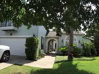 Beautiful  3 bdrm. home with large tropical patio, hot tub in gated community