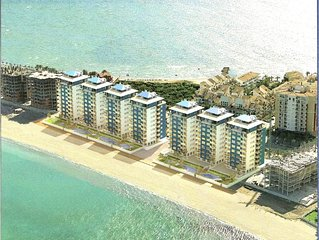 Luxurious 2-bedroom air conditioned beach front apartment on La Manga Strip