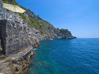 Villa Bice is a splendid and luminous two-story villa built sheer above the sea