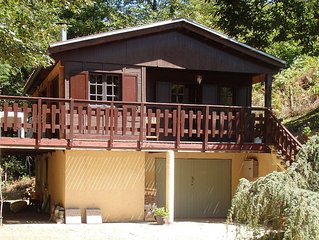 Idyllic chalet in rural location next to a river, ideal for the outdoors.