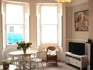 Elegant 2 bedroom Regency apartment with secluded garden. Sea views. Sleeps 4