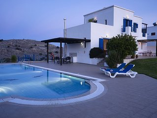 Villa for six. Large pool, sea views, lawned gardens. Near beach and amenities.