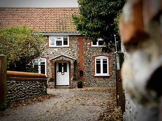 Luxury 4 bedroom North Norfolk cottage in lovely coastal village location