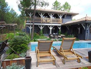 Superbe villa en bois, piscine chauffée, spa,tout confort, entre océan et bassin