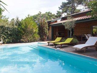 Grande villa avec piscine chauffée, bassin et océan à pied. Un havre de paix.