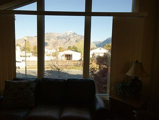 Beautiful mountain views and CLEAN!!   Four bedrooms and 1/2 block to bus line.