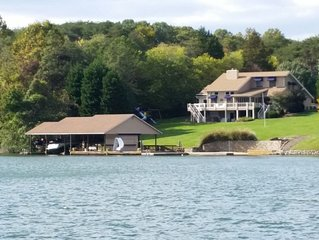 Beautiful Home with one of Lake's Largest Docks, Sand Beach, Hot Tub, WiFi, etc.