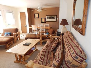 Log accented furnishings, updated kitchens and bedrooms in this spacious 2 bedro
