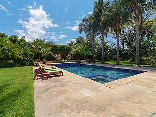 Tropical Luxury Retreat near the beach. Heated pool & spa with automatic cover.