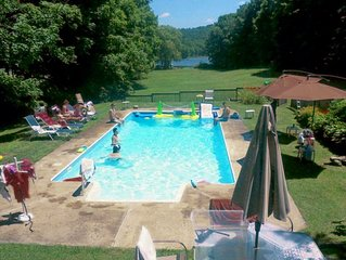 AWAY FROM THE CITY. LAKE AND HEATED  POOL 5 bedrooms 4 bathrooms