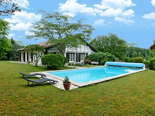 Experience this Basque Style Retreat with Charming Gardens and Heated Pool