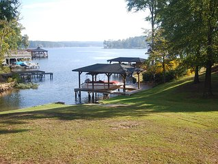 Charming Lakefront Cottage with Two Large Decks, Boat Ramp, and Wifi