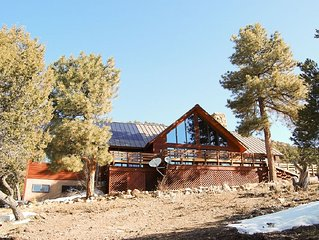 Secluded, air-conditioned, mountain home with gorgeous views and 40 acres to ro