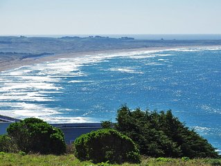 Panoramic ocean views of the beach and the Point Arena Lighthouse