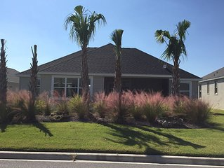 BRAND NEW HOME w/GOLF CART! ENJOY PEACE & QUIET WITH EASY ACCESS TO ALL THE FUN!