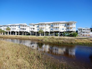 Overlooking the Gulf of Mexico! Gulf Breeze Condo #107- Private Ramp and Slip!