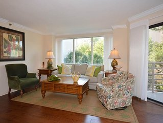 Beautiful Condo with Amazing Courtyard Views, Private Balcony and a Short Walk