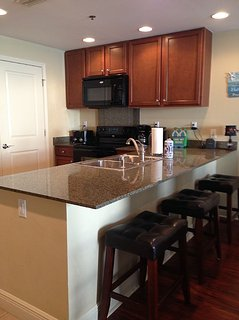 Great kitchen with granite countertops and eating bar.