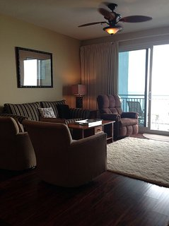 Grand room with rocker recliner swivel chair overlooking the Gulf.