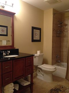 Family bathroom off hallway with tub.