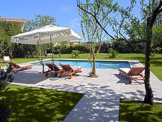 An impressive large villa with swimming pool and beautiful gardens