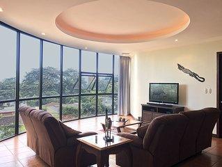 Beautiful 3 Bedroom Condominium with Panoramic Views, lush gardens, and more.