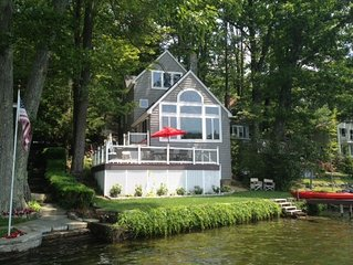 Elegant private waterfront home with peaceful sunset view from deck and dock