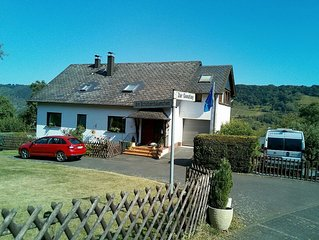 Self-contained holiday flat with garden access and views of the Mosel vineyards
