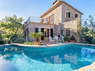 Attractive stone faced villa near Deia with sea views and private pool.