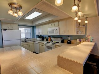 2BR / 2BA - Walk right out to the pool and the beach!