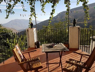 Lovely village house with terrace, grapevine and spectacular mountain views