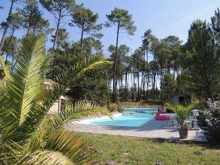Charmante villa neuve en bois dans la foret, calme, proche lac, plages et golf