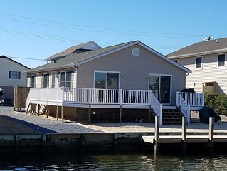 Charming one story canal front home, quiet neighborhood, one mile from ocean