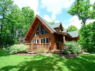 Stake a claim on District Creek! Pristine and sophisticated, this log-style dom