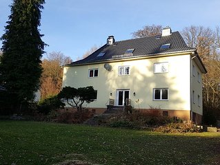 Apartment near the forest with a large garden with playground, barbecue, firepl
