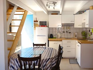 Coquet T2 + mezzanine apartment 4/6 pers. for holidays feet in the water!