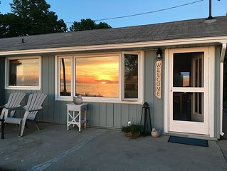 A water lover's dream! Sun rises and sunsets from a cottage perched on a dune.