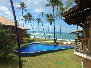 Village de luxo com  piscina e enfrente ao mar WIFI