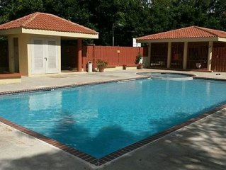 Lovely condo w/ pool in gated community near beaches, shopping, and attractions