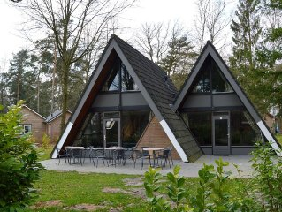 This attractively furnished group house lies on a small natur rich holiday park
