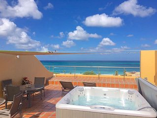 Amazing Penthouse w/ Majestic Views of Eagle Beach! rooftop hot tub!